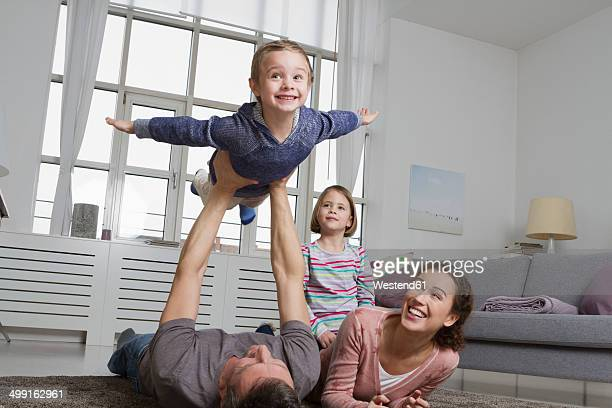 Playful family in living room