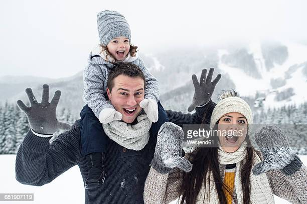 Playful family in winter landscape