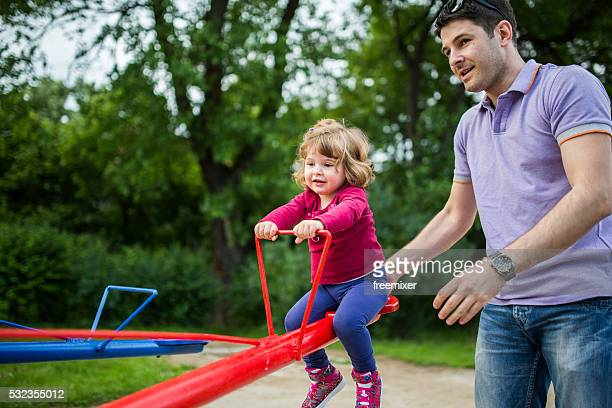 Playful family on the playground