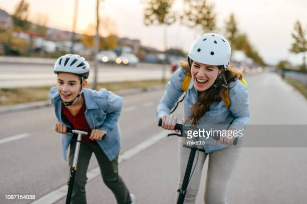 playful family - sports helmet stock pictures, royalty-free photos & images