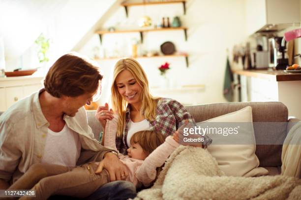 playful family - scandinavian descent stock pictures, royalty-free photos & images