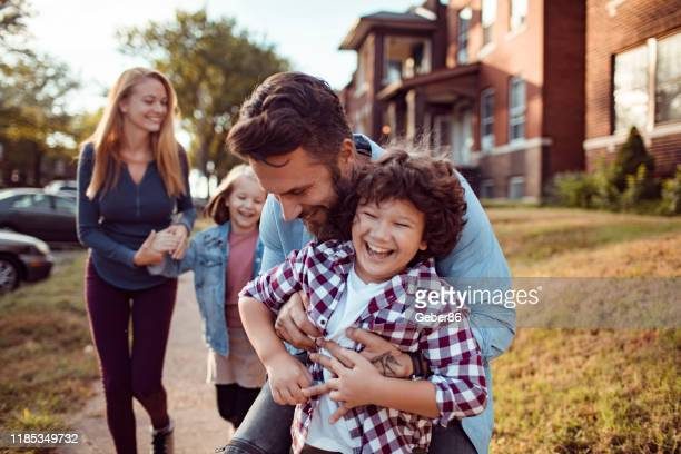 playful family - st. louis missouri stock pictures, royalty-free photos & images