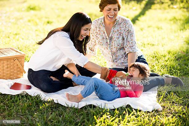 playful family - mexican picnic stock pictures, royalty-free photos & images