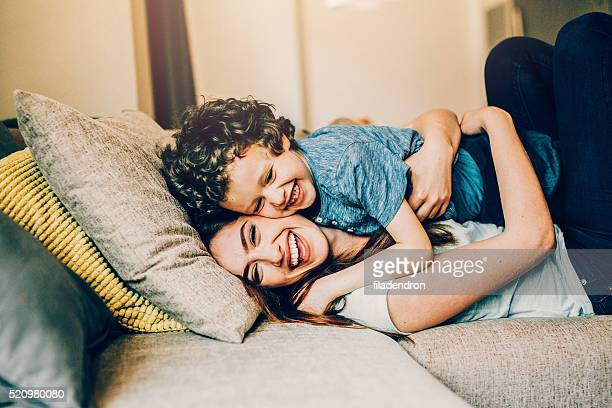 playful family - mother and son stock photos and pictures