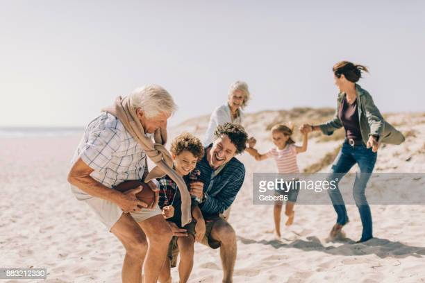 playful family - multigenerational family stock photos and pictures