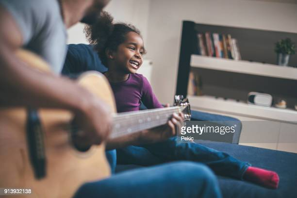 playful family - modern manhood stock pictures, royalty-free photos & images