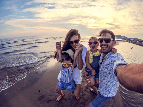 Playful Family selfie with wide angle camera 1096158132
