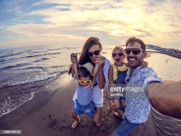 playful family selfie with wide angle camera - family vacation stock pictures, royalty-free photos & images