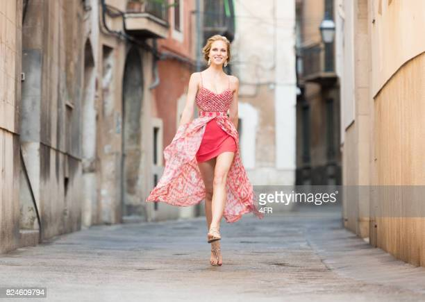 Playful Fashion, Model running down an Alley in Spain