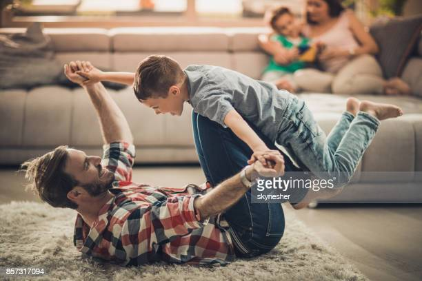 Playful father and son having fun while spending time at home.