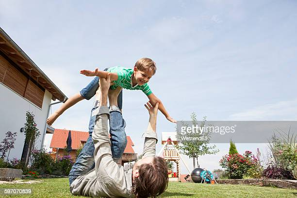 Playful father with son in garden