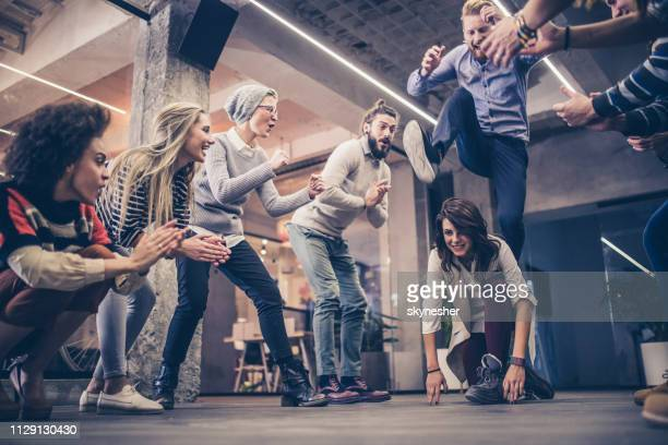 playful freelancers having fun on a break at casual office. - escapism stock photos and pictures