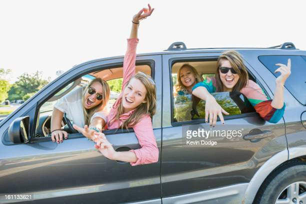 Playful friends in car