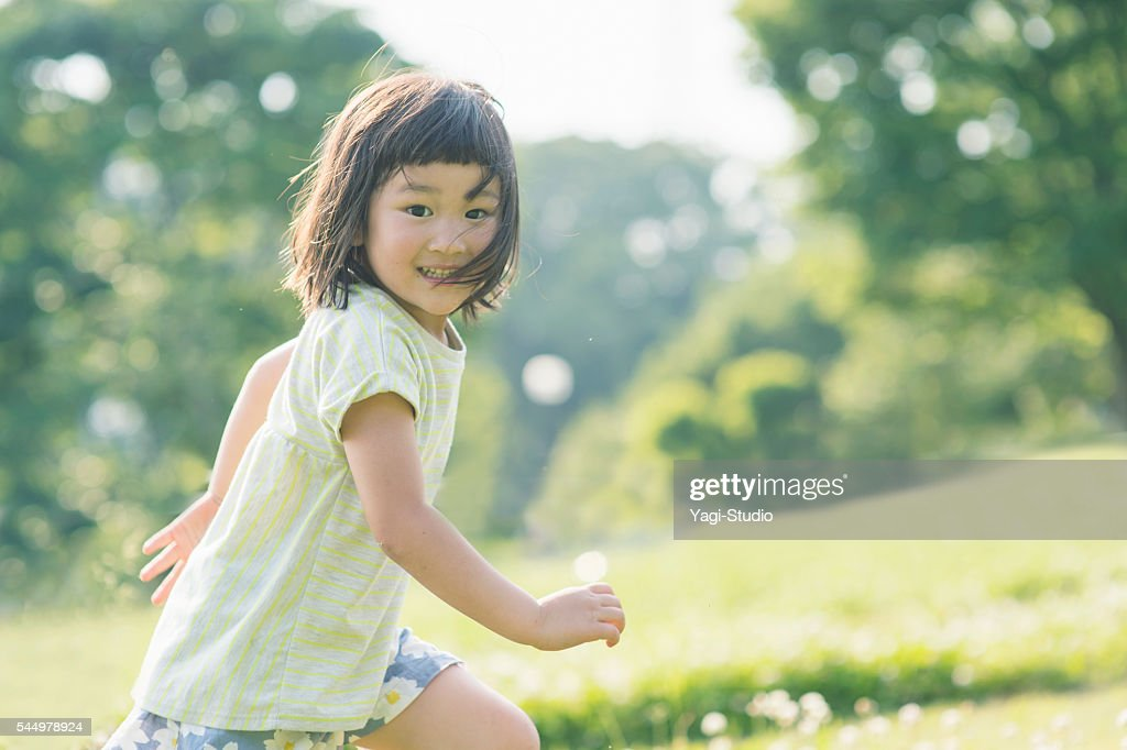 Playful girl having fun time in nature : ストックフォト