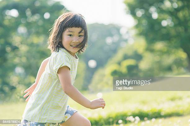 playful girl having fun time in nature - childhood stock pictures, royalty-free photos & images
