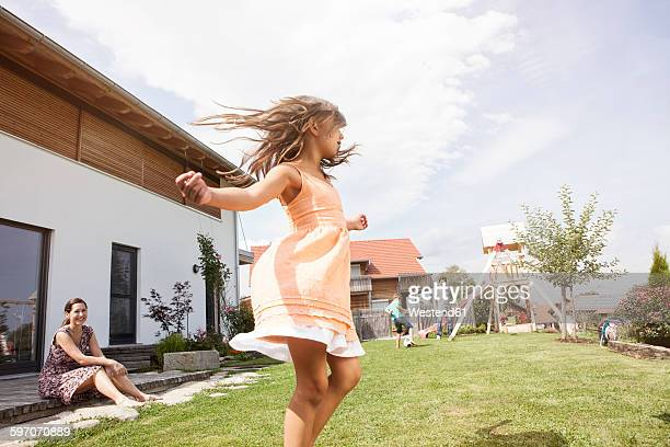 Playful girl with family in garden