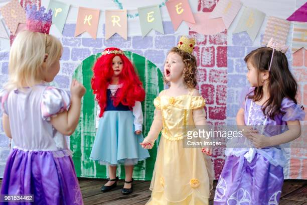 playful girls against castle painting during princess party - princess stock pictures, royalty-free photos & images