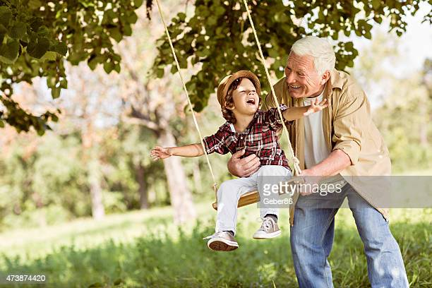 playful grandfather - swinging stock pictures, royalty-free photos & images