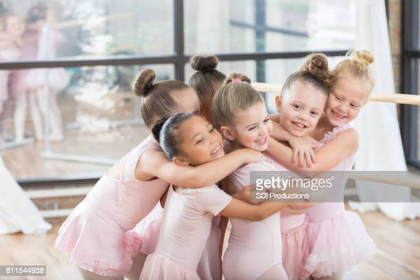 Playful group of young ballerinas