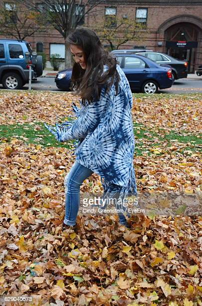 Playful Happy Young Woman Running In Park