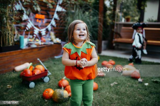 playful kids enjoying a halloween party - halloween stock pictures, royalty-free photos & images
