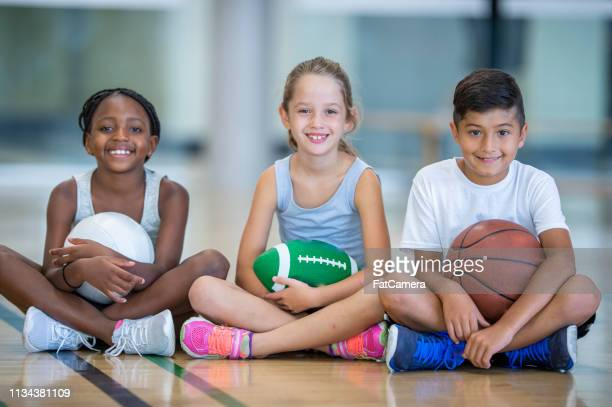 playful kids - volleyball sport stock pictures, royalty-free photos & images