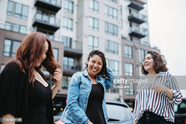 playful latina friends outdoors - tacoma stock pictures, royalty-free photos & images