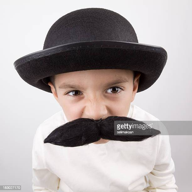 Playful Little Boy With Big Handle Bar Mustache And Hat