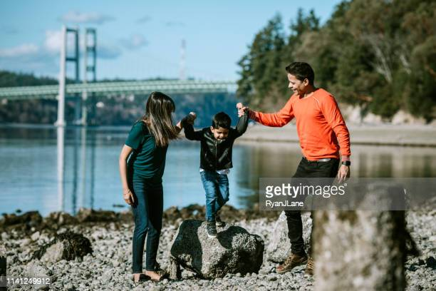 playful loving indian family at beach together - indian culture stock pictures, royalty-free photos & images