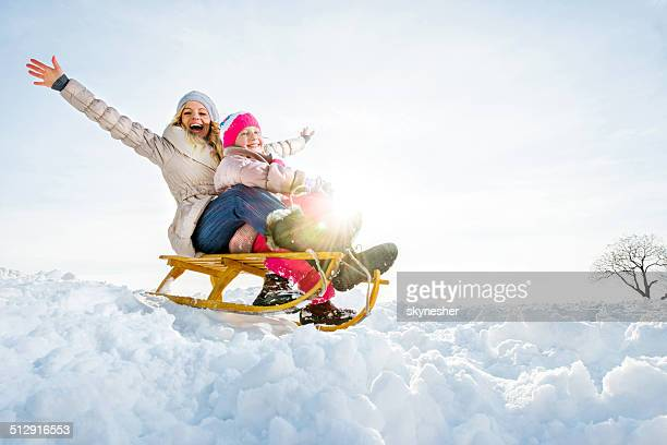 Playful mother and daughter in winter.