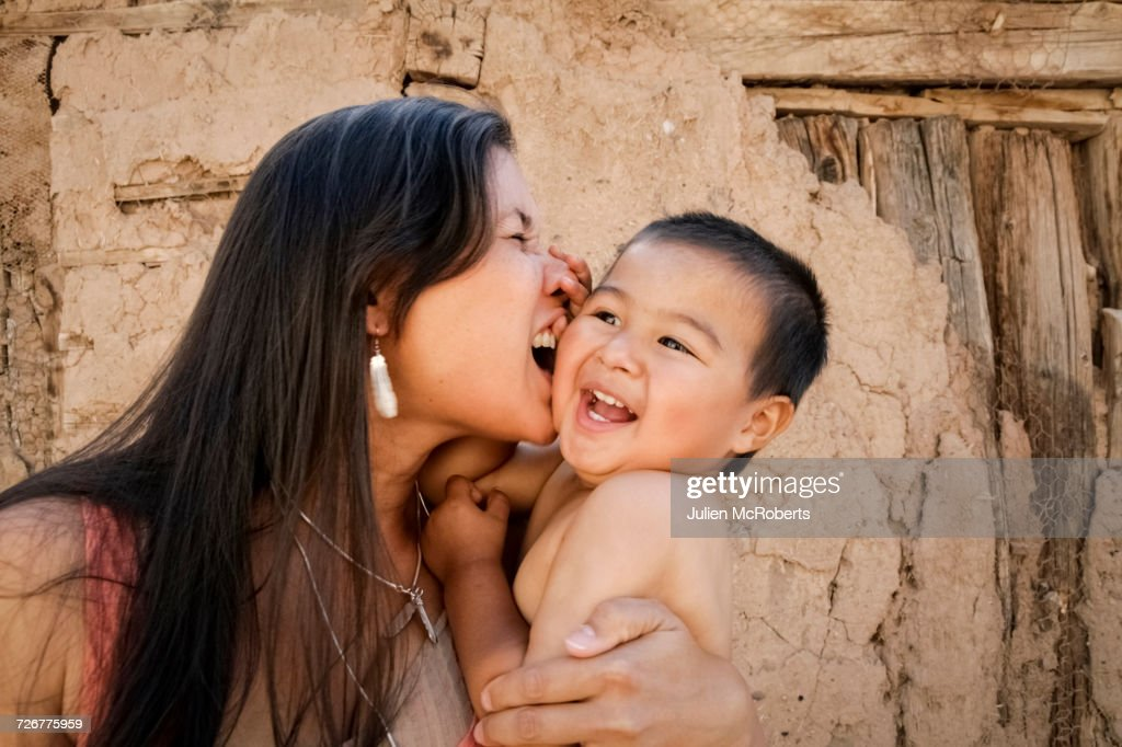 Playful mother holding son outdoors : Stock Photo