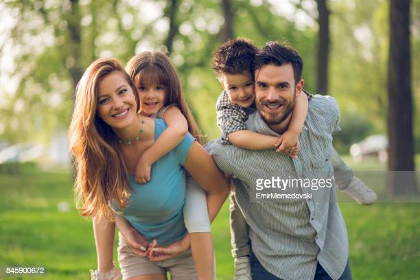 Playful parents having fun with their children outdoors