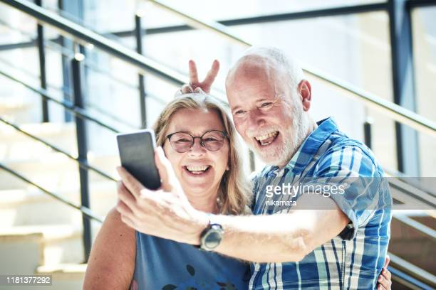 playful senior couple taking selfie - ukraine stock pictures, royalty-free photos & images