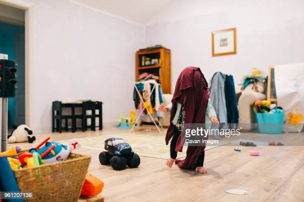 playful toddler running with towel on head at home - messy stock pictures, royalty-free photos & images