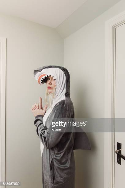 playful woman in shark costume - fashion oddities stock pictures, royalty-free photos & images