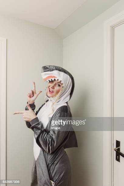 playful woman in shark costume - animal costume stock pictures, royalty-free photos & images