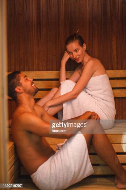 playful young couple at sauna - black woman in sauna stock pictures, royalty-free photos & images