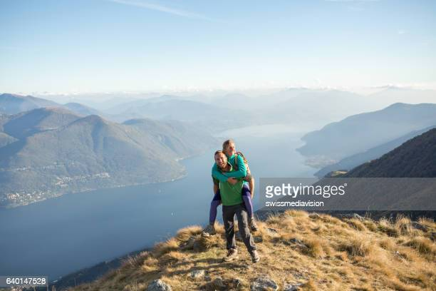 Playful young couple on mountain top
