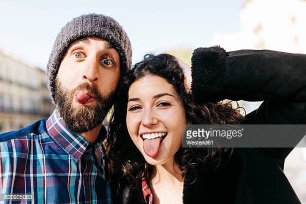 playful young couple pulling faces - grimacing stock pictures, royalty-free photos & images