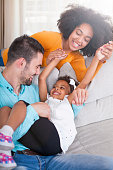 Playful young family at home.