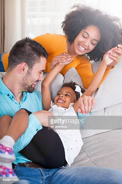 playful young family at home. - vreugde stockfoto's en -beelden