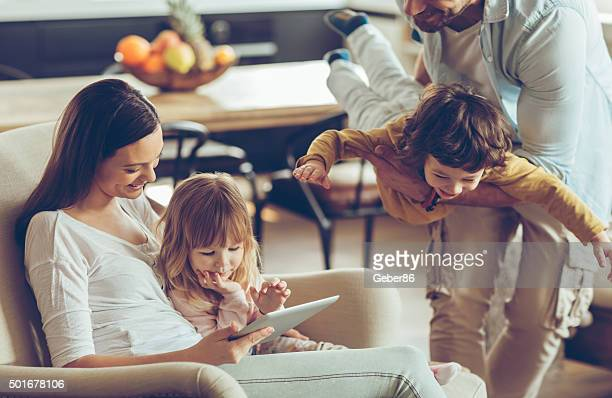 playful young family - lifestyles stock pictures, royalty-free photos & images