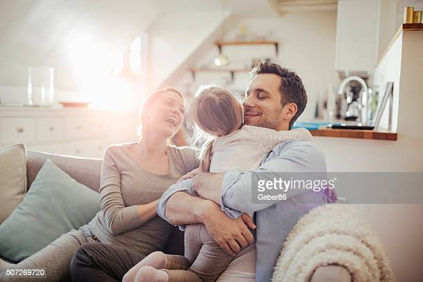 playful young family - at home stock pictures, royalty-free photos & images