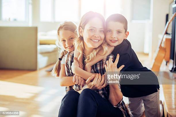 playful young family - family with two children stock photos and pictures