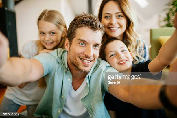 Playful young family taking a selfie