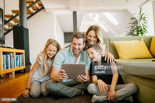 Playful young family using a tablet