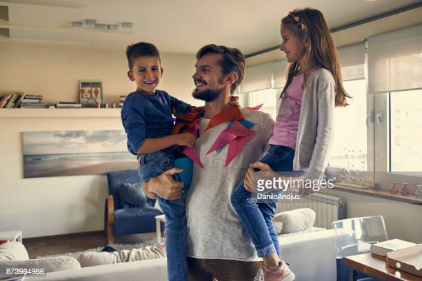 father playing with his children