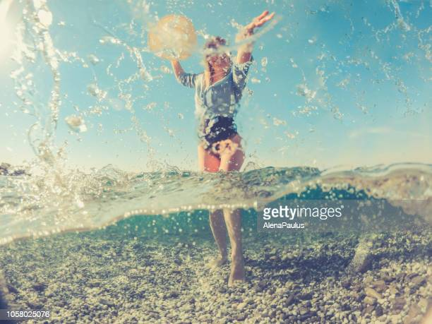 Playful Young Woman in the Split Sea, half under water half above
