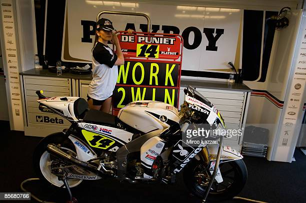 Playgirl demonstrates Randy De Puniet's bike in front of the box for the presentation of the new sponsor Playboy during Irta Test on March 28 2009 in...