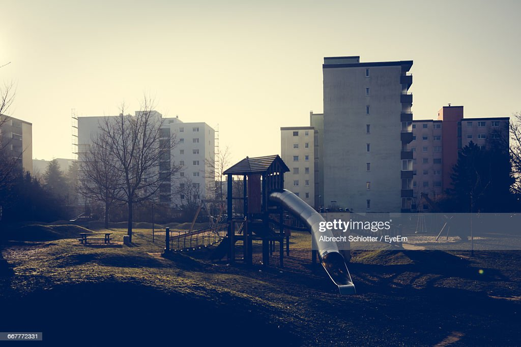 Playground Against Built Structures : Stock-Foto